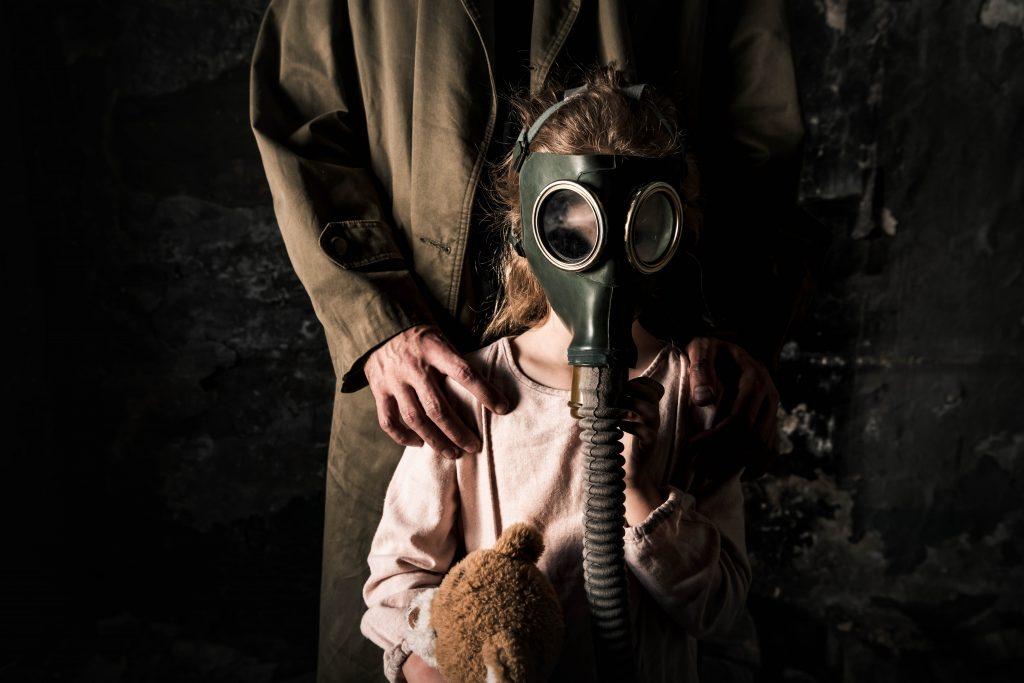 kid wearing gas mask